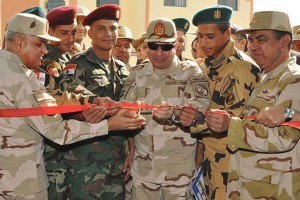 Handout photo of Armed Forces General Abdel Fattah al-Sisi cutting the ribbon as he attends the opening ceremony of the NCOs' Institute in Cairo